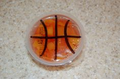 Basketball team snack... fruit-cup-turned-basketball using a permanent black marker  :)