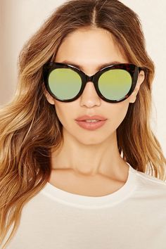 A pair of cat eye sunglasses with mirror lenses and tortoiseshell frames.   accessorize Round 7846fd1932d8