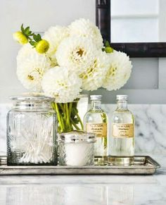 A beautiful idea for guest bathroom decor. Thoughtful host though: Fill the jars with commonly used essentials for your guests comfort and convenience.