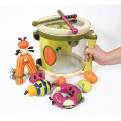 A pack of 8 wonderfully appealing instruments which all make beautiful sounds. Parum Pum Pum Drum kit includes drum with handle and strap, 2 drumsticks, jingle bells, maraca, clacker, tambourine and 2 egg shakers, all which fit inside the drum for easy storage.