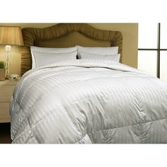 Slip under the soft 100-percent cotton of this gender-neutral Siberian white down comforter and sleep the night away. This elegant comforter features a classy striped pattern and pairs well with many different sheet colors, from basic white to bold red.