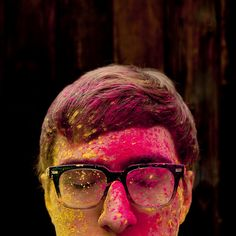 """""""Our youngest Phoot Camper blinked, and along came one of my favorite of my own photos."""" -Laura Brunow Miner  Photo of William Wilkinson sporting his Warbys. Will had just come from a wild holi powder shoot where anyone brave enough to model came away covered head to toe with pigment."""