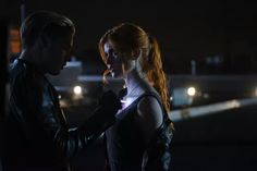 Jace and Clary, jace is drawing  something