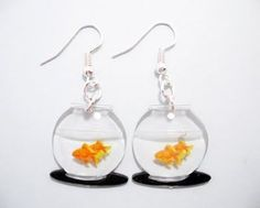 Oh my, I love to wear earrings that my students marvel over. This would do it!... http://mikiyecreations.blogspot.com/2009/10/fun-find-of-day-goldfish-bowl-earrings.html