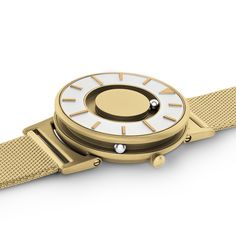 The minimal design features raised indices so the wearer can tell the time by touch. A polished gold triangular marker at twelve o'clock, and linear segments at each hour provide graphic details. Dezeen Watch Store, Telling Time, Minimal Design, Gold Watch, Watches For Men, Bracelet Watch, Mesh, Rose Gold, Unisex