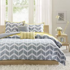 Add a fun and contemporary vibe to your bedroom with the Elle five-piece comforter set from ID-Intelligent Design. With a fun chevron print, this soft bedding set brightens up your bedroom with a play Comforter Sets, Yellow Comforter, Purple Duvet, King Size Bedding Sets, Grey Duvet, Teal Bedding, Mustard And Grey Bedroom, White Bedrooms, Bedding