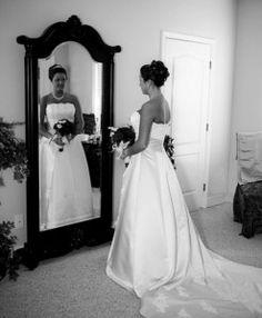 Bride looking in mirror - front