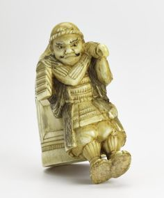 Netsuke of carved ivory, Musashibo Benkei carrying off the Miidera temple bell: Japan, 19th century