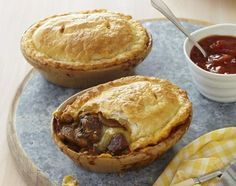 """Who doesn't love pies? Filled with steak cheese and mushrooms, these pot pies are sure to satisfy cravings. 😁 Search: """"Steak, Cheese & Mushroom Pot Pies"""" on our website for the recipe! Simply Yummy, Beef Pies, Cheese Pies, Cheese Sauce, Mince And Cheese Pie, Homemade Pie, Empanadas, Samosas, Pie Dish"""