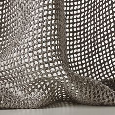 TRESSAGE col. 003 by Dedar - This leno weave is woven with a bulky silky-looking yarn and has a soft, full-bodied hang. The great contrast between the pronounced thickness of the material and the open weave of the fabric, allowing for the light to filter through, makes Tressage a protagonist.