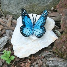 Butterfly Bronze Garden Statue: Blue Butterfly by Design Toscano. $35.00. Hand finished. Lost wax bronze casting. Design Toscano exclusive. Enjoy butterflies in your garden year-round with our butterfly bronze set upon a natural stone. Our butterfly statue is cast in premium, solid bronze using the centuries-old lost-wax method and is then hand-painted in vivid, durable color and affixed to a genuine, natural stone base. Due to natural variations in the stone, each bronze b...