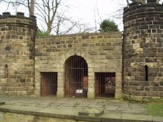 """""""The Bear Pit, Cardigan Road, Headingley, Leeds  The Bear Pit is all that remains of the Leeds Zoological and Botanical Gardens, a not very successful Victorian venture. It was built in 1840, and the bears were displayed in a circular pit on the far side of this wall. The public viewed them from the tops of the turrets, one of which has a spiral staircase (the other probably had one as well.) The Leeds Civic Trust restored it in 1966""""  Quote taken from website: www.geograph.org.uk"""