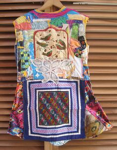 MyBonny Wearable Collage Folk Art altered tShirt which has an apron on frontside & 2 large hand  hem sweep 62  I added many scraps and tidbits, including:  quilting scraps rhinestone button beach girls sailboat Hawaiian print crochet embroidery, plaid, flowers polka dots Asian ethnic embroidery silk Southwestern linen birds Bonny Gorsuch in Cannon Beach, Oregon, USA..