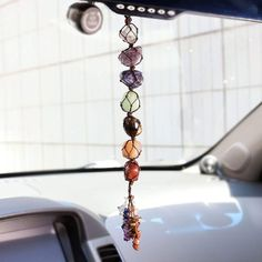 Infuse your daily life with conscious crystal energy with this 7 Chakra Gemstone Tassel. Made of pure natural stones, this lovely tassel with help fill your aura and environment with positive energy and protection, while keeping your chakras aligned and balanced. The 7 chakras are vortexes of energy in the body, with each chakra representing specific parts of our being -- physical, emotional or psychological. Having balanced chakras is important as it helps to complement one's spirit and well-be Chakra Crystals, Chakra Stones, Chakra Beads, Chakra Bracelet, Clear Quartz Crystal, Crystal Healing, Healing Gemstones, Feng Shui Ornaments, Hippie Car