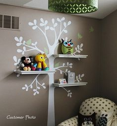 nursery ideas- branch shelving.