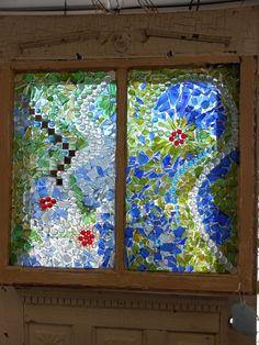 Mosiac glass window.  This is my second window project using several broken glass pieces from bottles.  I do not use a pattern when I do this, just begin to lay down each piece of glass at random using a silicone glue.