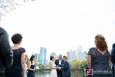 Bride and groom by lakeside ceremony at intimate Piedmont Park wedding from Destination + Atlanta wedding photographers Matthew Druin + Co. NO TRAVEL FEES IN THE US!