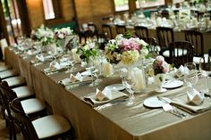 I love the simplicity of this talbe setting.  Great combination of linens and flower colors.