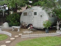 How cool to put a vintage trailer in the back yard instead of a shed or a clubhouse! Overnight guests would have a place to stay too!