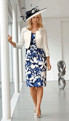 Condici Cream and Navy cap sleeved print crepe dress and plain jacket with contrast piping and corsage. Matching hat, hatinator and disc fascinator (see pictures below). Please call the shop for available sizes. JUST ARRIVED!