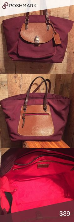 "DOONEY & BOURKE Pocket Tote Plum large shopper tote by Dooney & Bourke.  Nylon all weather material with 1 snap close and 1 zippered exterior pocket.  Full zip top closure, red interior with 1 zip and 3 slip pockets (1 with snap close).   11"" tall x 17"" wide x 7"" deep with a double strap drop of 9 inches.  A few marks on the bottom of the interior is the only wear displayed.  No wear to exterior. Dooney & Bourke Bags Totes"