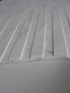 "Integrated drain board in ""rain cloud"" corian! Yes please!"