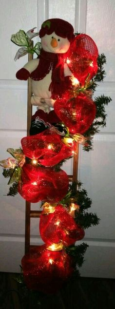 Christmas Ladder - Sparkle a hallway or wall with this fun ladder instead of tradition tree or in addition to it. Add holiday shine to the foyer, porch, lobby, den or hallway. Create a theme. with color or decos. a tropical Chirstmas ladder? Disney Christmas, Christmas Snowman, Winter Christmas, All Things Christmas, Christmas Holidays, Christmas Wreaths, Christmas Ornaments, Ladder Christmas Tree, Christmas Projects