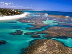 Porto de Galinhas is a famous beach in the Northeast of Brazil, located in Ipojuca in the state of Pernambuco. His fame is due mainly to natural beauty: pools of clear water and warm formed between reefs, estuaries, mangroves, white sand and palm trees.