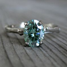 Oval Green Moissanite Twig Engagement Ring, 1.3ct., via Etsy.