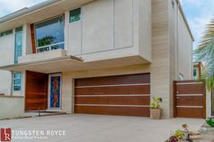 Modern sectional garage doors with aluminum inlay. Matching modern side gate for entry. Home clad with exterior wood. Cheap Garage Doors, Garage Door Paint, Garage Door Styles, Wood Garage Doors, Garage Door Makeover, Garage Door Design, Wooden Doors, Contemporary Garage Doors, Modern Garage Doors