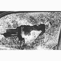 Shattered glass frames the head of Henry Smurra, shot dead outside a Brooklyn doughnut shop. Known as 'Hank the Bank,' Smurra was ordered shot by Colombo hit man and later underboss William (Billy Fingers) Cutolo during a 1991 power struggle for control of the family business.