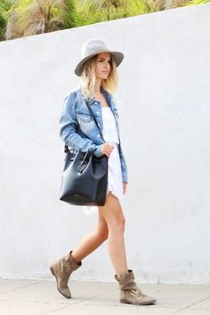 I love this look. I love the idea of pairing a jean jacket with a dress. It looks super cute spring or summer. I really like her hat too!