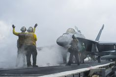 SOUTH CHINA SEA(Nov.2,2013)Sailors assigned to US Navy's forward-deployed aircraft carrier USS George Washington (CVN 73) prepare F/A-18E Super Hornet from Eagles of Strike Fighter Squadron (VFA)115 for take off on ship's flight deck.George Washington & embarked air wing,Carrier Air Wing(CVW)5,provide combat-ready force that protects & defends the collective maritime interest of the U.S. & its allies and partners in the Indo-Asia-Pacific region.(USN Mass Comm Spec 3rd Class Ricardo R.Guzman)