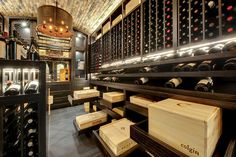 Custom Wine Cellar - Movable, self-closing wooden shelving providing effortless access to wine cases Wagner St., Glenview, Glenview Haus Photo Gallery, Chicago