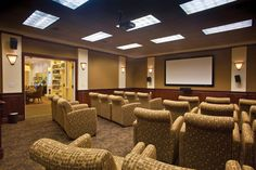 Photo: The Gardens at Town Square senior living private movie theater - Era Living