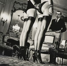Two Pairs of Legs in Black Stockings, Paris by Helmut Newton