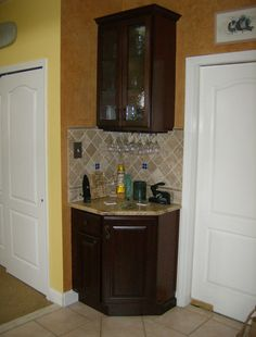 corner wet bar designs | who hired us to install their kitchen island also wanted this dry bar ...