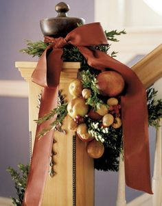 Wire together real fruit, such as limes, small apples, pears, and lemons (they'll last for about two weeks), secure them at intervals along the garland, and finish with lustrous vintage satin ribbon.