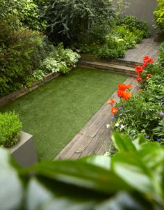 lovely way to squeeze in a bit of grass in a small garden.  This would also be adorable in a tucked away part in a more wild portion of the yard.