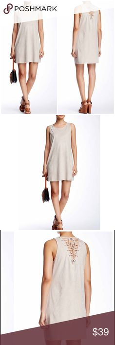 """Strappy Back Faux-Suede Shift Dress Stone colored faux-suede mini dress is outfitted with a lace-up back for a contemporary take on the retro classic. Polyester/spandex. Approx measurements: length 34""""...Small 32/23/34.... med 34/25/36... large 36/27/38 Dresses Mini"""