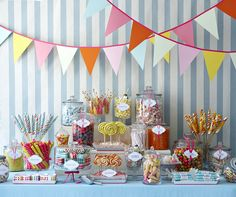 Candy Bar at the reception! How cute! Provide bags to put the candy in and guests can fill it up and take it home as a wedding favor. I could totally see my sister doing this for her wedding, it would be a perfect fit for her!