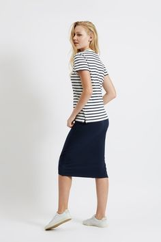 Calf-length pencil skirt with stretch and side slit. A simple, lithe skirt adds polish to your work wardrobe. 95% Organic Certified Cotton, 5% Elastane jersey.