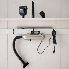 so cute...might be good under the bathroom sink for cleaning up hair, Metro hand vacuum (West Elm)