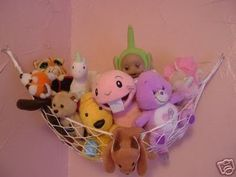 Stuffed animal wall nets. Remember Quel? Above our bed.. N we played teddies till late into the night, we thought it late at least..
