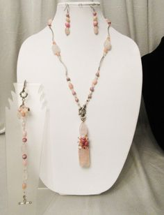 """Pendant-1 1/2"""" Carved Rose Quartz suspended by Pink Opal, Pearl and Rhodocrosite Cluster and large carved Rose quartz, Hung by Tibetan Silver rope ring    Reversible Necklace- 25 1/2"""" long- Rose Quartz, Pink Peruvian Opal, Rhodocrosite, Czech Crystal, Silver Noodles, Tibetan Silver Toggle Clasp    Bracelet - 7 1/2""""-Rose Quartz, Pink Peruvian Opal, Rhodocrosite, Czech Crystal, Silver Noodles, Tibetan Silver Toggle Clasp. Removable multistone dangle at the clasp    Earrings 2 1/4"""" long- Rose…"""