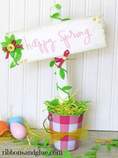 Welcome Spring with this cute Spring Sign made from a painted wood plaque,a  paint stirrer stick, Silhouette cut file and various Spring ribbons.  Super cute Spring craft idea!