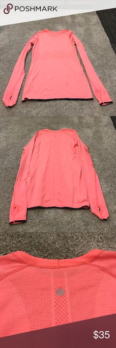 Lululemon Swiftly Tech Long Sleeved Crew Shirt Long sleeved lululemon athletica swiftly tech Crew shirt. Comes in bright Coral color, with black edging on the sleeves and bottom. lululemon athletica Tops Tees - Long Sleeve