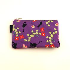 Black Kitties and Flowers Purple:These little bags are the perfect accessory to keep you organized! They measure 6 inches by 4 inches and can be used as camera bags, change purses, wallets, makeup bags, really anything AND they make great gifts too. All Wolf Bait brand bags are interfaced to retain shape, padded for comfort and soft enough to fold. No visible raw edges... $10.00