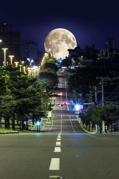 I love this picture because it looks like the moon is right on top of the street. Also, the streets create leading lines.