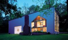 Bunny Lane recycled shipping containers House by Adam Kalkin Back by Night